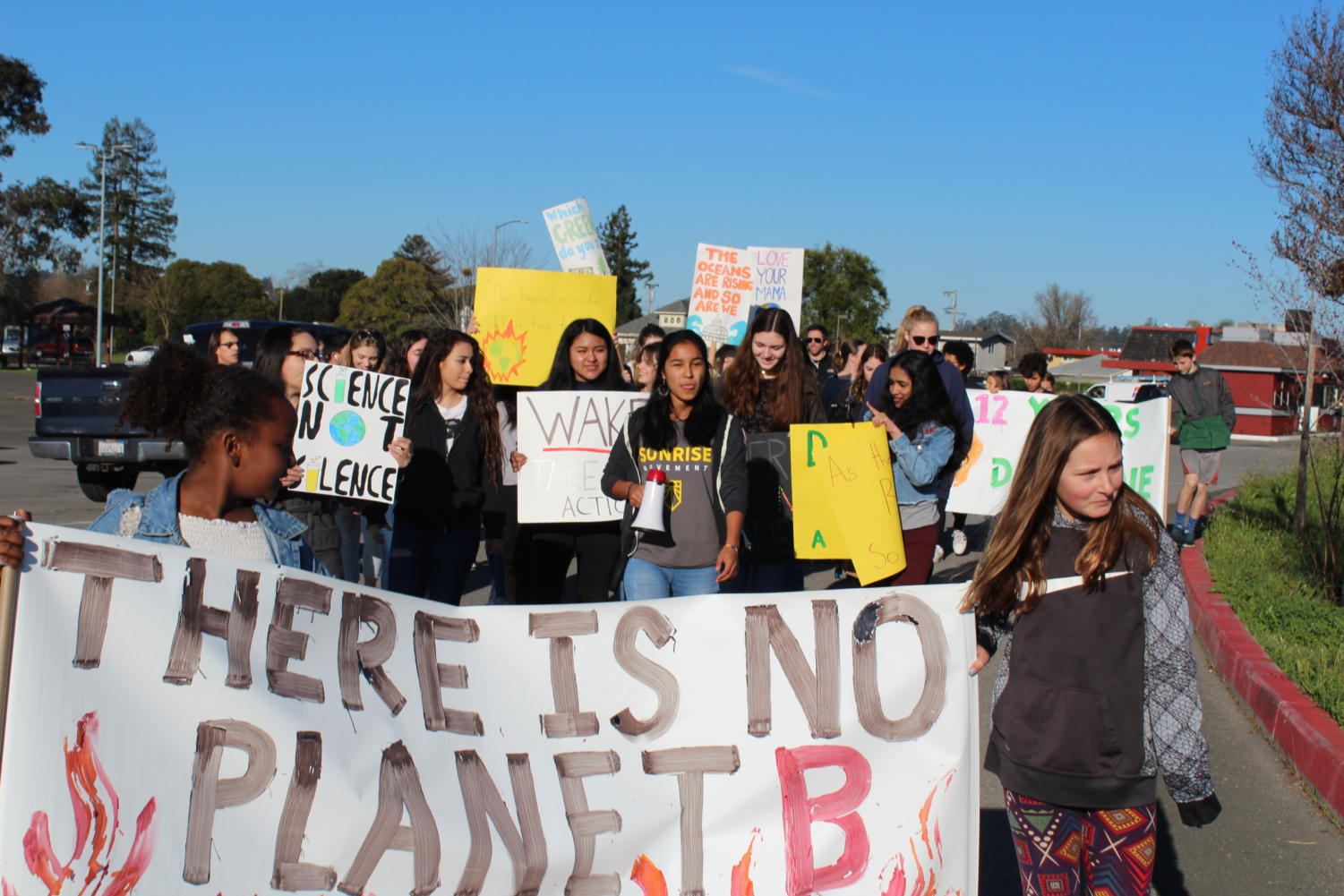 Live Oak Elementary School and Casa Grande High School students walk together through the streets of Petaluma to advocate for climate change.