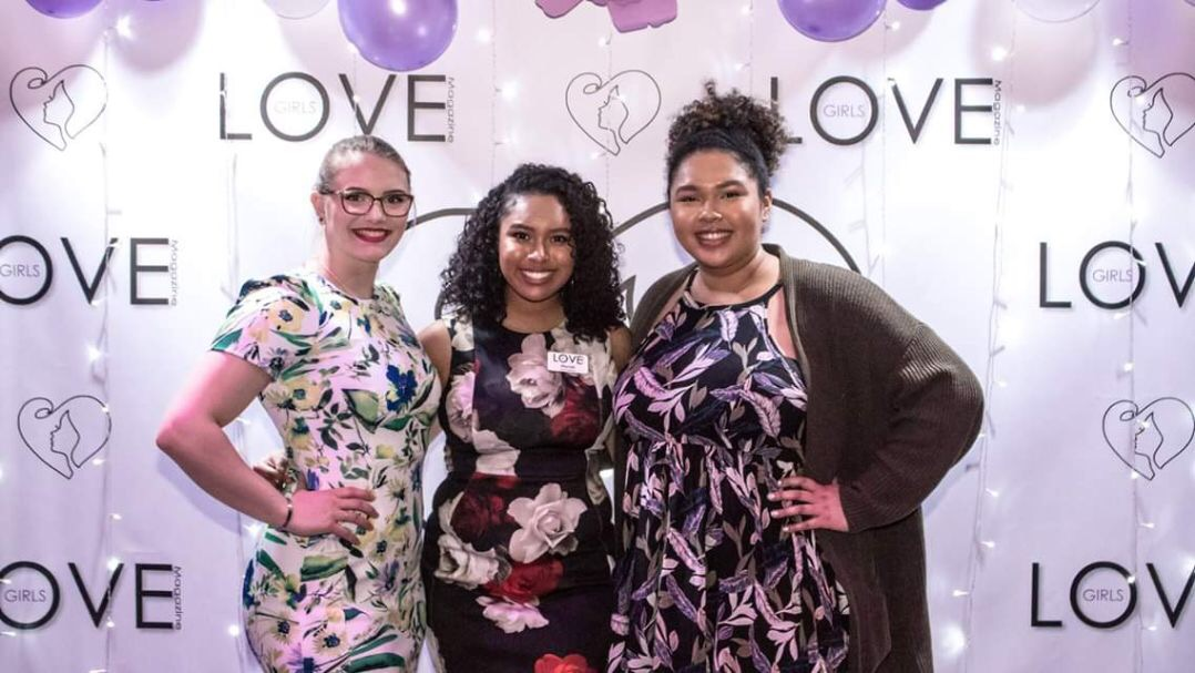 "Senior Mariah Martinez, middle, poses with Hannah Olka, and her sister, PV alumna TaKera Martinez, right, on the Love Award's ""purple carpet."""