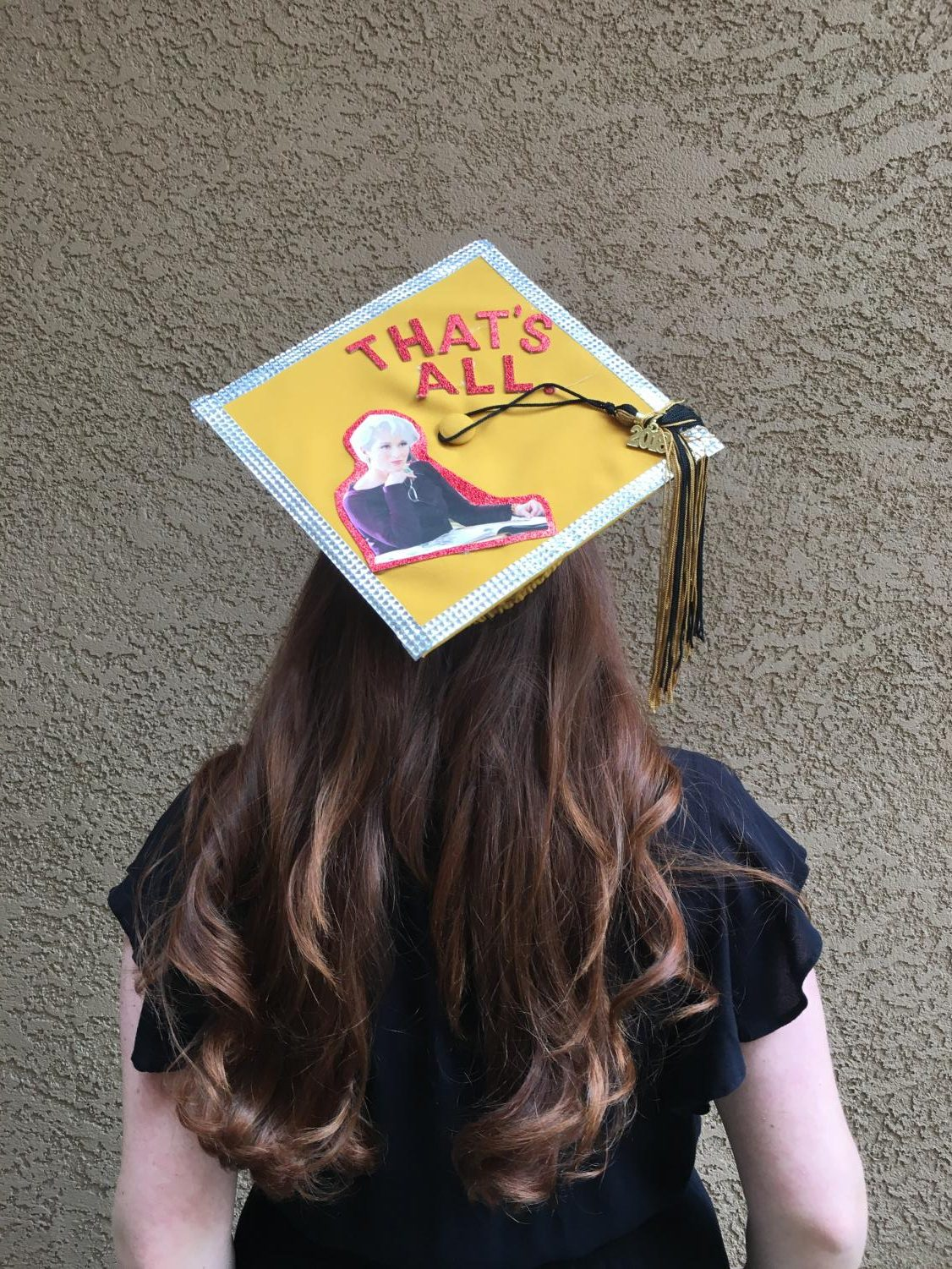 Ashley Lazar's graduation cap with a quote from Meryl Streep in