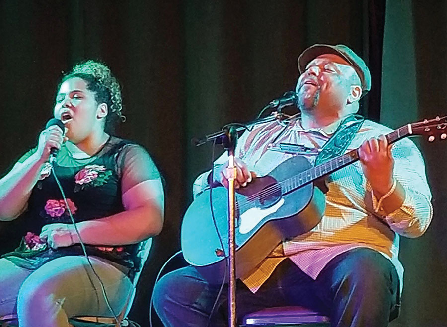 "Phoebe Burt '21 and her father Kevin Burt sing and play ""Lean On Me"" by Bill Withers at Wildwood Saloon in North Liberty earlier this year."
