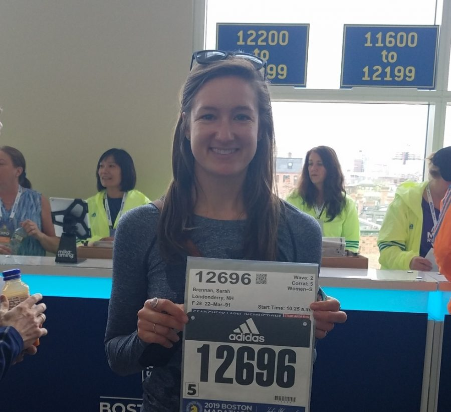 Math+teacher+Ms.+Brennan+shows+off+her+recent+Boston+Marathon+number.