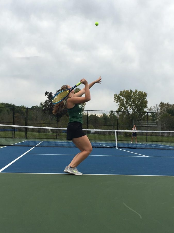 Varsity+tennis+player+Katie+Eippert+is+seen+serving+at+Highland+Heights+tennis+courts.+