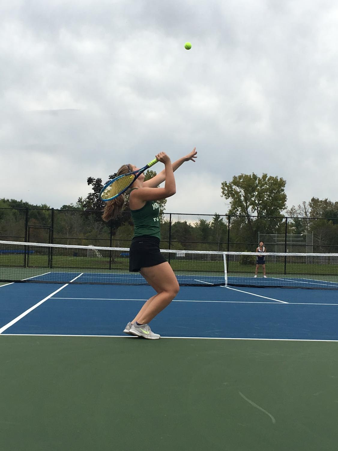 Varsity tennis player Katie Eippert is seen serving at Highland Heights tennis courts.
