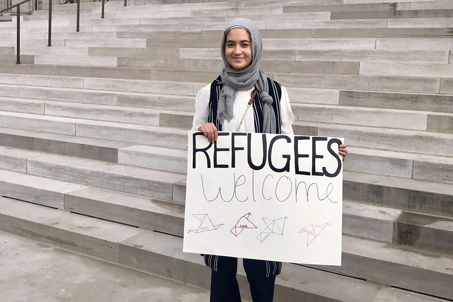 "Standing in front of the Missouri capitol building, sophomore Ulaa Kuziez shows her support for Syrian refugees. Kuziez visited Jefferson City with the Council of American and Islamic Relations (CAIR). ""There are definitely some negative aspects to standing out, being a Muslim immigrant in a majority white high school,"" Kuziez said. ""At times it can get a little uncomfortable or a little awkward, but I choose to be unapologetic about my identity and about being a Muslim, Syrian-American woman."""
