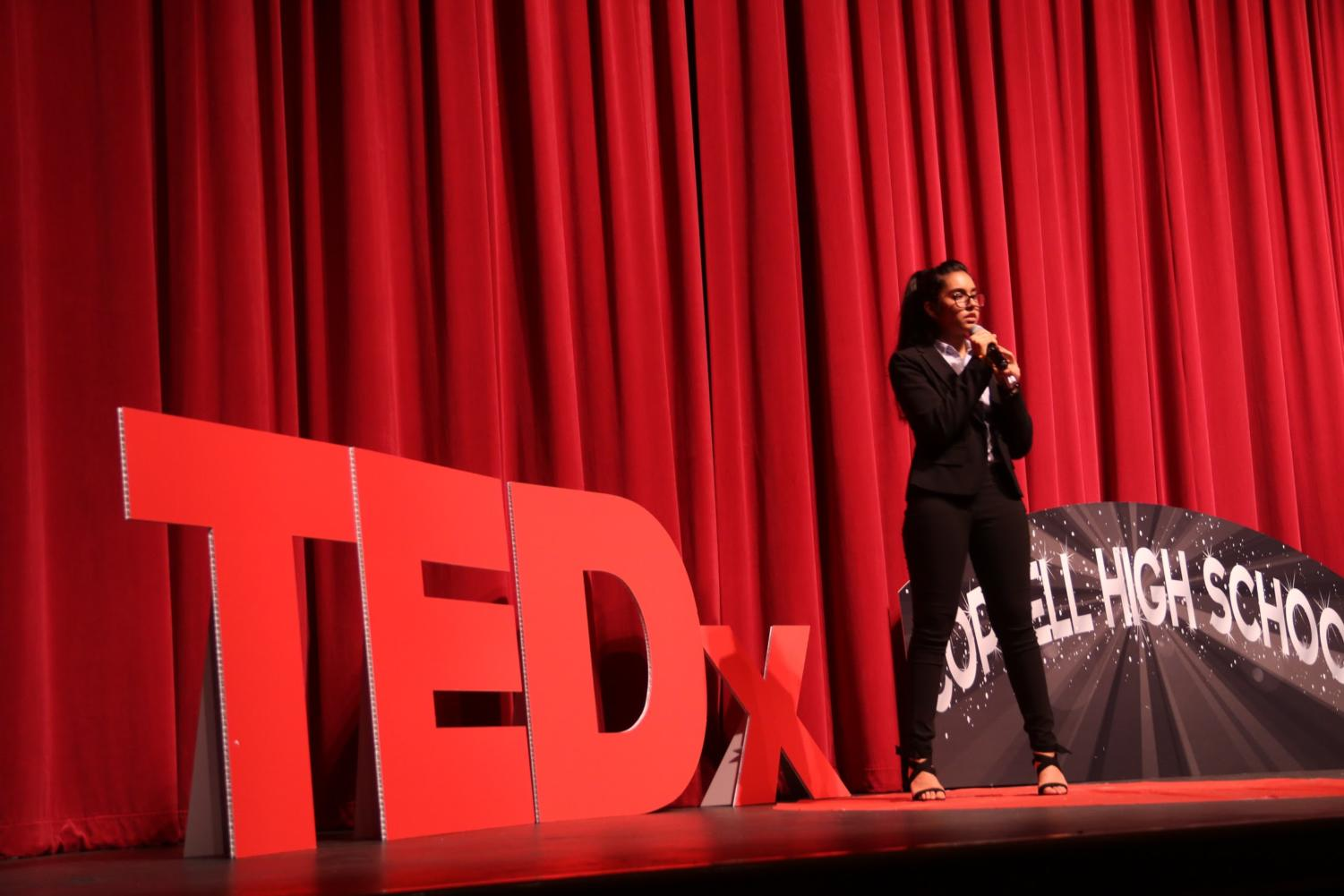 """Coppell High School senior Aditi Mutagi discusses the burning of the Amazon rainforest during her TedxYouth Talk at CHS on Wednesday night. The event's theme was """"the world reimagined"""", and speech topics ranged from showing gratitude to social media addiction."""