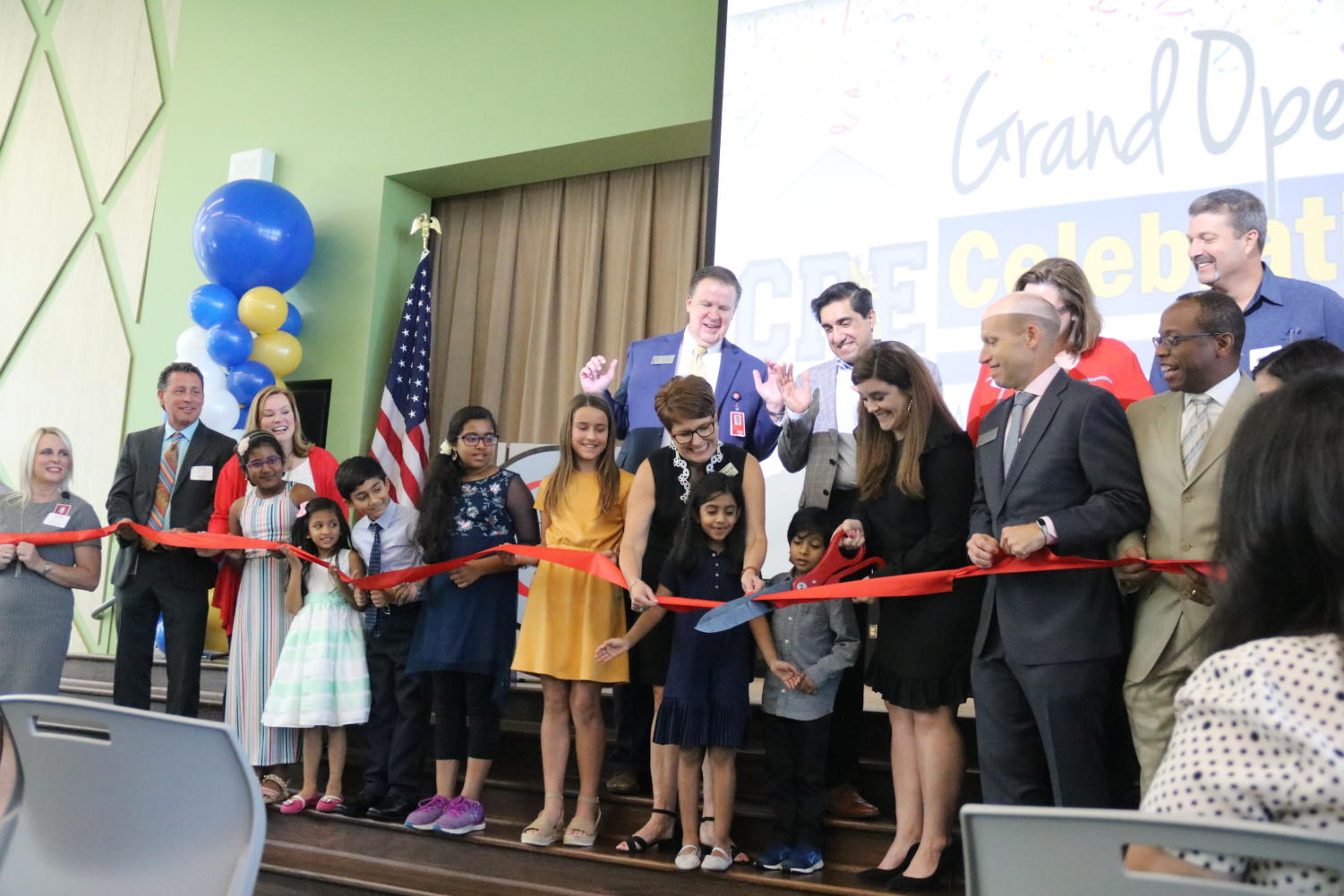 On Wednesday, Canyon Ranch Elementary Principal Ashley Minton cuts the red ribbon to commemorate the official opening of the school. CRE is the 11th CISD elementary school and was built to combat the overpopulation issues throughout CISD schools.