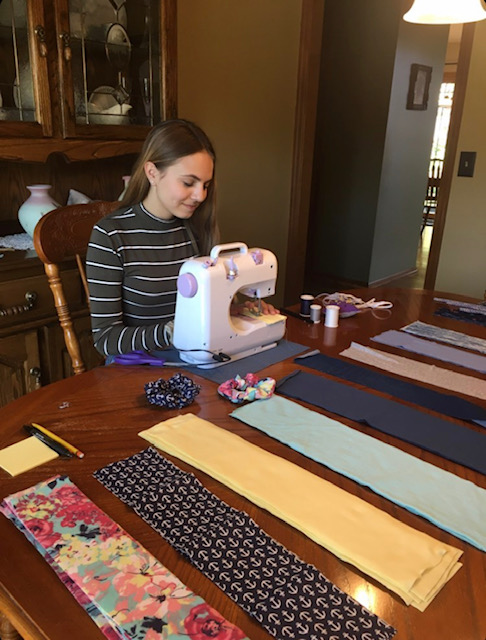 When+one+enters+the+Zieg+household+it%27s+not+uncommon+to+see+junior+Emily+Zieg+working+diligently+on+sewing+scrunchies+for+her+business+ScrunchEEZ.+Zieg+gained+interest+in+sewing+during+middle+school%2C+but+she+didn%27t+start+producing+the+scrunchies+until+this+year.+%22All+of+my+friends+were+really+excited+when+I+told+them+I+was+going+to+start+this+business%2C%22+Zieg+said.+%22They+all+wanted+me+make+one+for+them+and+pay+me+for+it%2C+which+I+thought+was+really+cool.%22