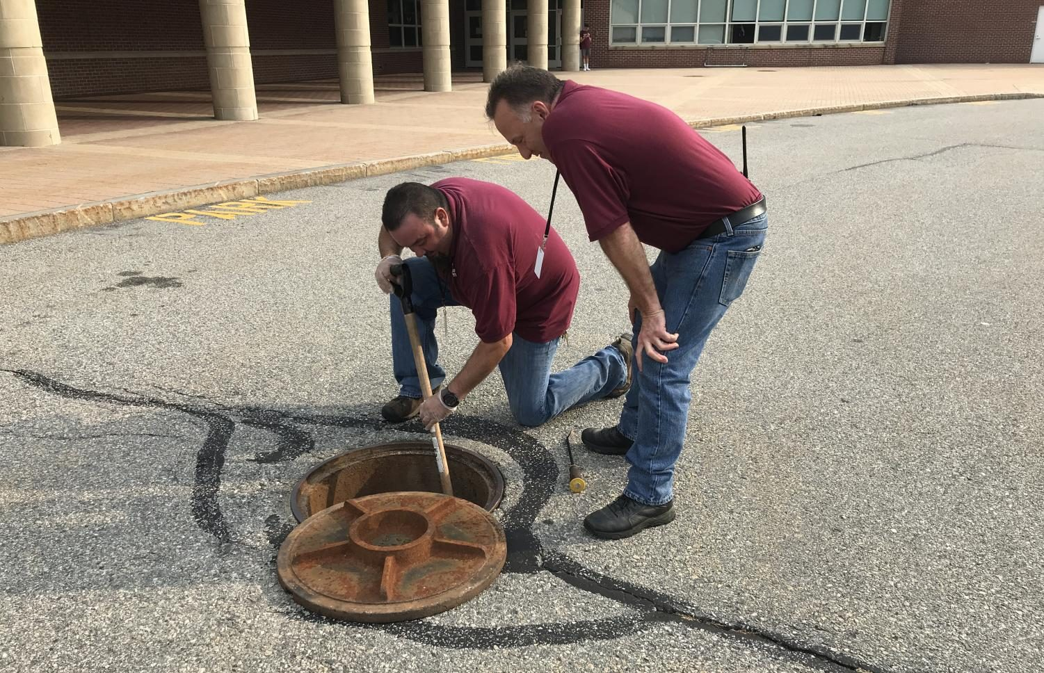 Custodian Norberto Chaves [left] and Director of Facilities Michael Gorman [right] work to fix a blockage on Sept. 4.