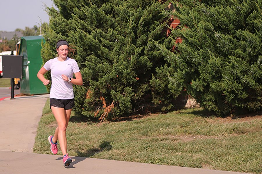 After receiving open-heart surgery, student competes for cross country team