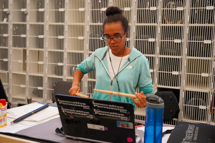 3:00 Snare captain Malia Wilson practices various cadences before the Friday night performance.