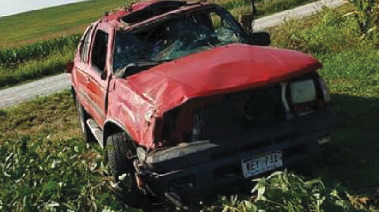 After losing control and rolling a few times, junior Kyle Baxter's SUV lands in a field in Weeping Water, Neb. Baxter was rushed to a local hospital with severe injuries. He was not wearing a seat belt during the September accident.