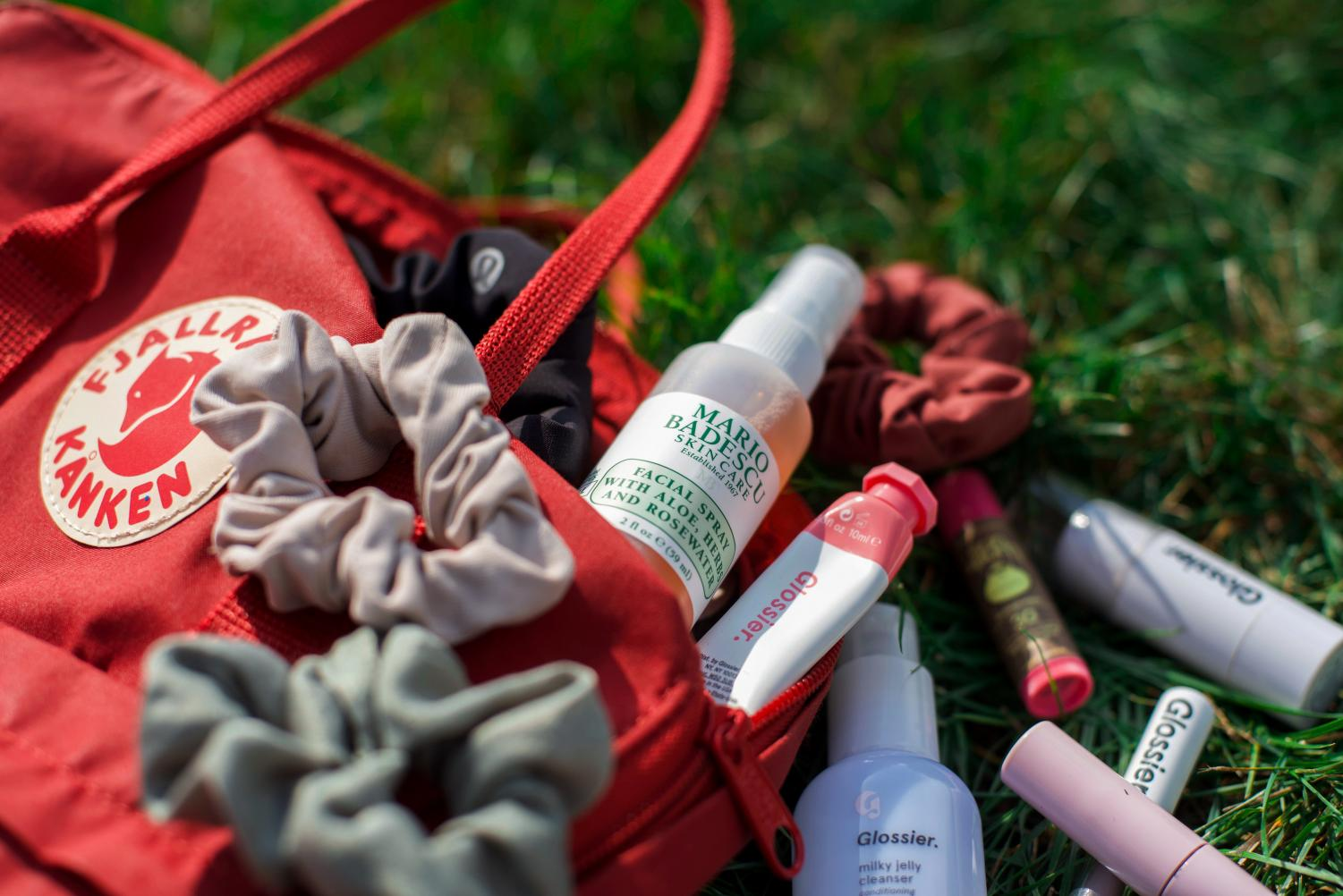 A Fjällräven backpack, a classic VSCO accessory, overflows with scrunchies and popular makeup products.