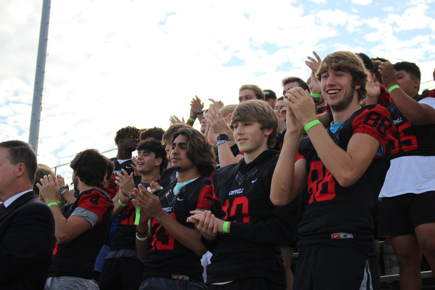 Coppell High School's varsity football team cheers on the varsity marching band at the UIL Region 31 Marching Contest at Standridge Stadium on Tuesday. The Coppell varsity marching band scored a 1, the highest possible score, at the contest.