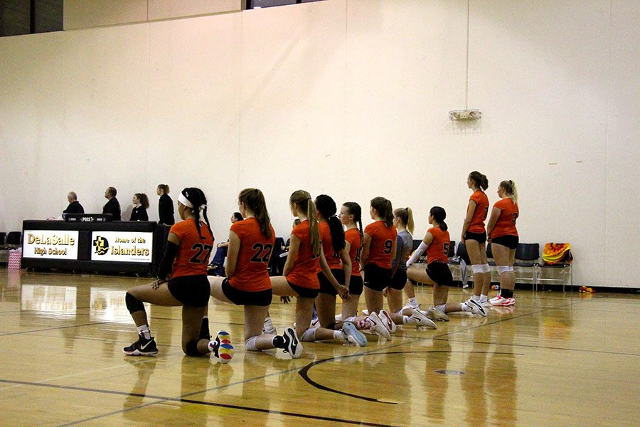 Volleyball team faces adversity when taking a knee during the national anthem