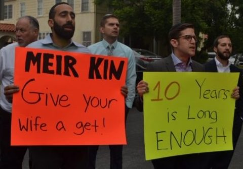 PROTEST: From left, Shalhevet faculty Rabbi Yitzchak Etshalom, Dr. Jonathan Ravanshenas, Mr. Chris St. Germaine, and Rabbi David Block stood outside a home on Poinsettia Place in Hancock Park to support Lonna Ralbag's right to a get, or religious Jewish divorce,  Aug. 23. Agunah activist Rabbi Jeremy Stern joined them, at right.