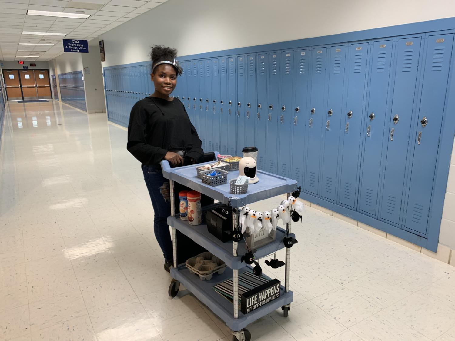 Freshman Jasmine Hawkins enjoys delivering coffee as part of the Mustang Mugs service.