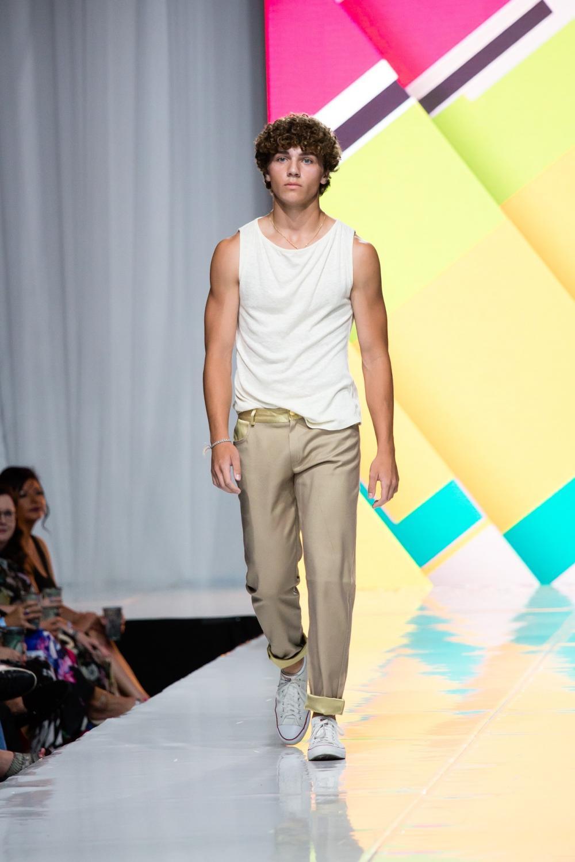 Junior Sam Falter walks on the runway for Omaha Fashion Week designer Paulie Gibson.
