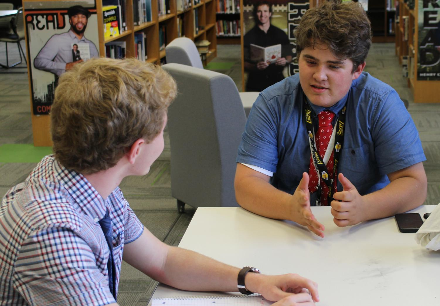 Senior Jack Chauvin, right, talks with reporter Chase Gravatte about becoming a published author of a children's book.