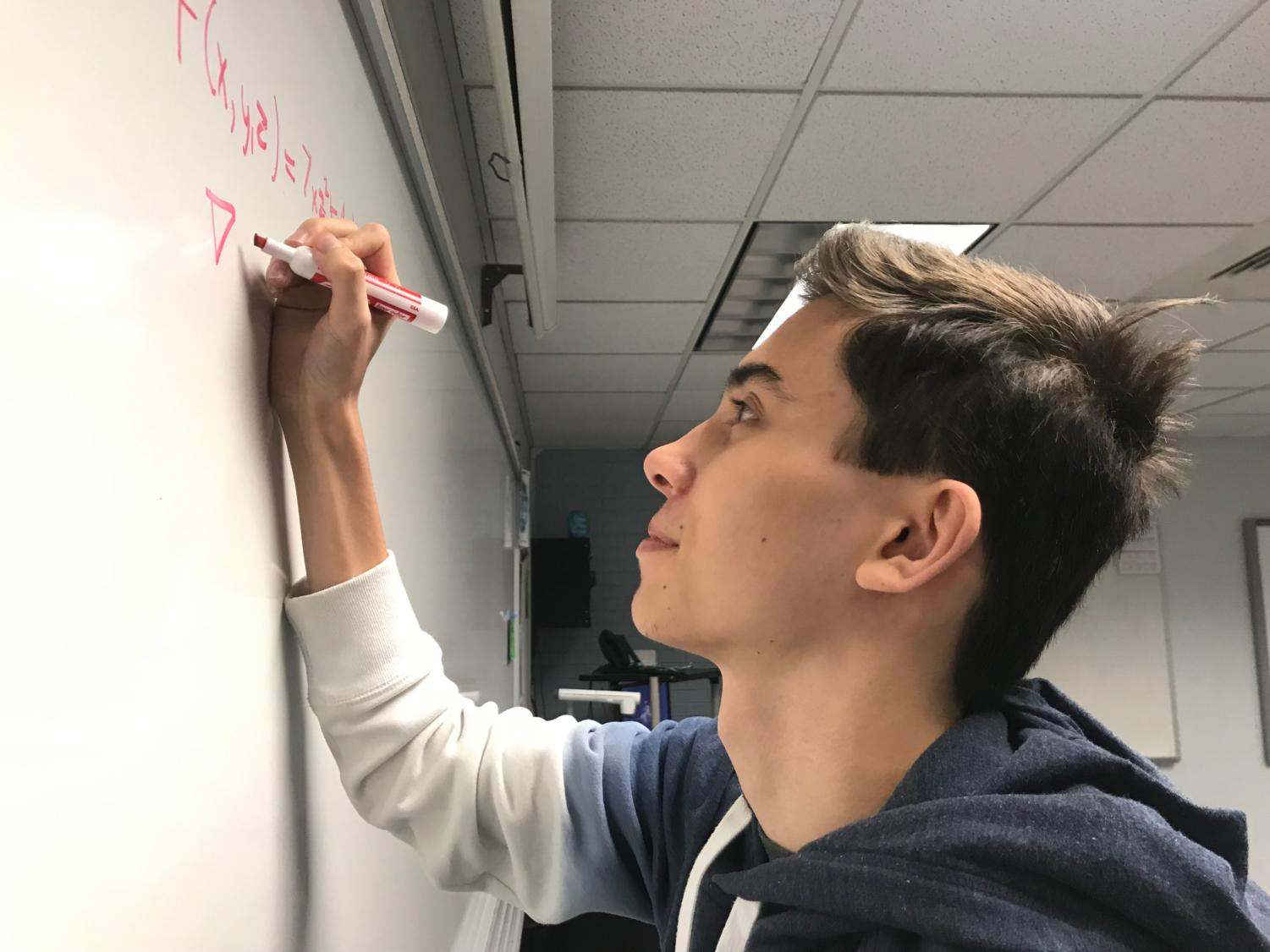 Junior Chris Sapinski works through one of his Calculus homework problems.