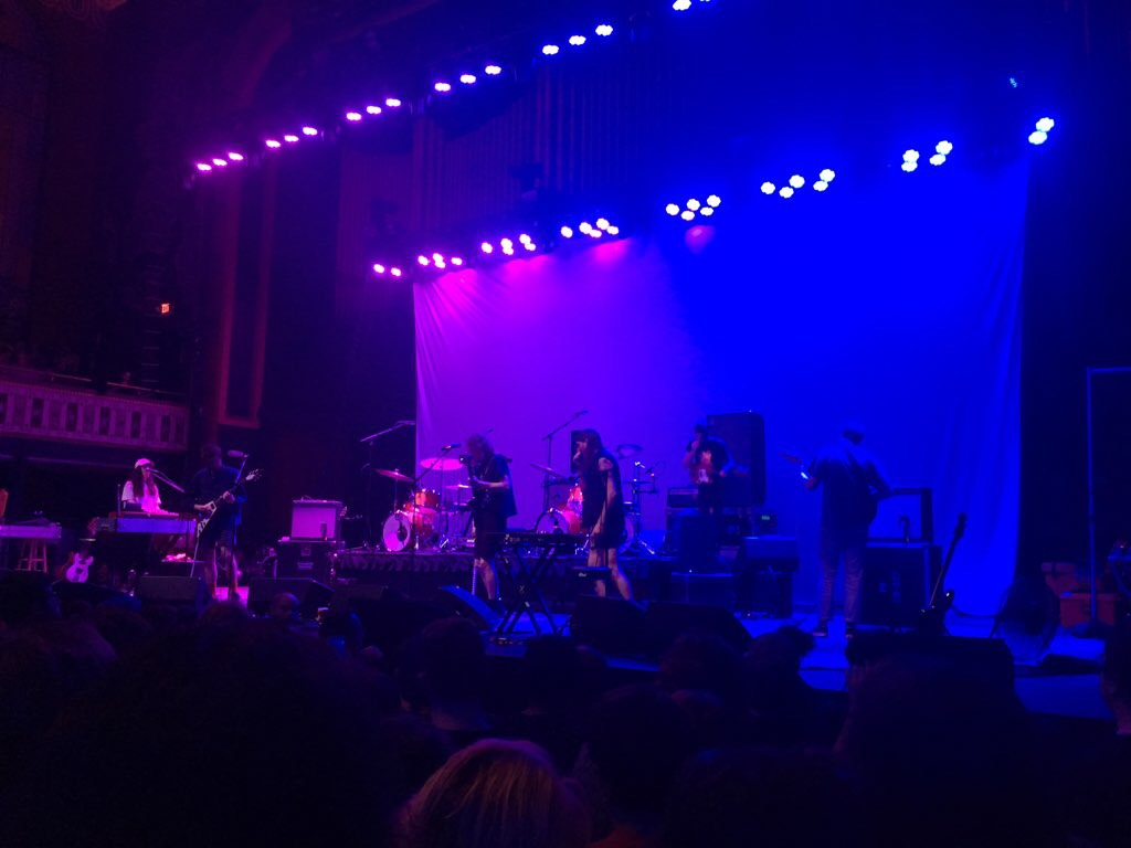 King Gizzard and the Lizard Wizard setting up for their set at the Tabernacle. Stu McKenzie checks guitars and Ambrose Kenny Smith checks microphones.