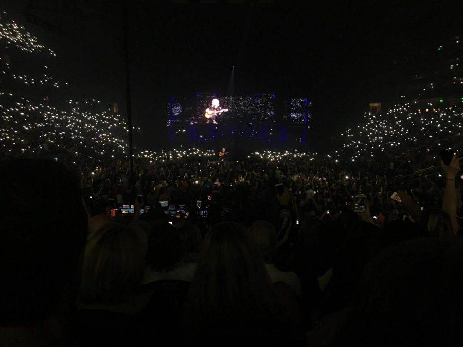 Brian+May+performing+%22Love+of+My+life%22+at+the+State+Farm+Arena.+The+crowd+singing+along%2C+carrying+the+song+while+swaying+their+flashlights.