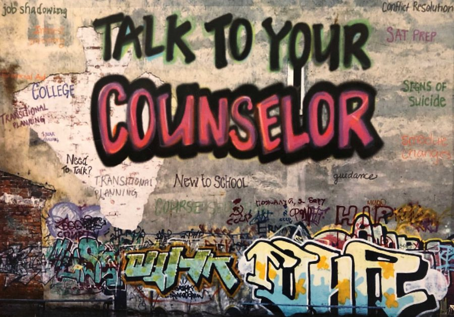 A+grafitti-styled+painting+on+the+wall+outside+Manual%27s+guidance+office+reminding+students+to+%22Talk+to+your+counselor.%22