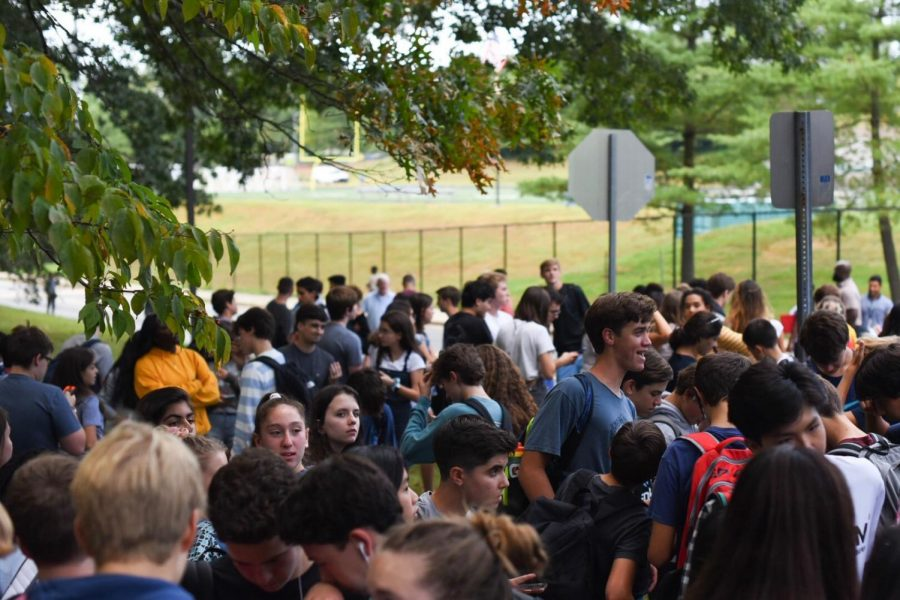 Students+evacuate+after+a+fire+alarm+on+Monday.+Before+the+evacuation%2C+a+student+assaulted+another+student%2C+though+the+two+incidents+were+unrelated.