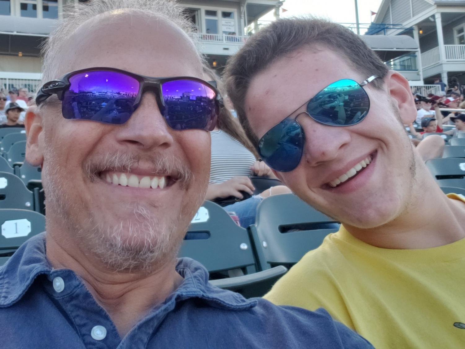 David and Justin Maroney smile prior to a Frisco Rough Riders baseball game in May.
