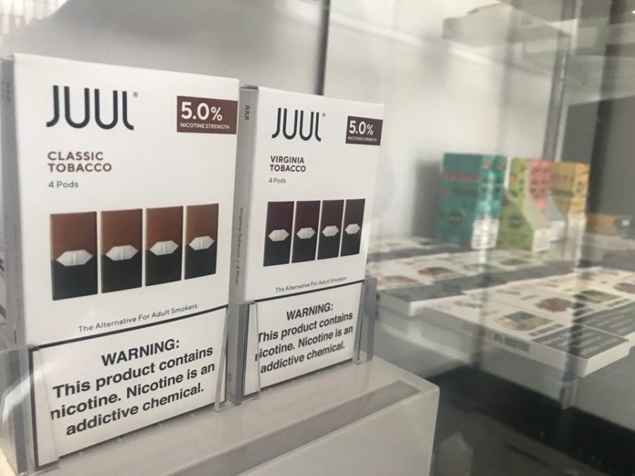 Juul+pods+are+sold+in+flavors+like+mint%2C+mango%2C+tobacco+and+menthal.+Each+colorful+pod+contains+as+much+nicotine+as+a+pack+of+cigarettes.+