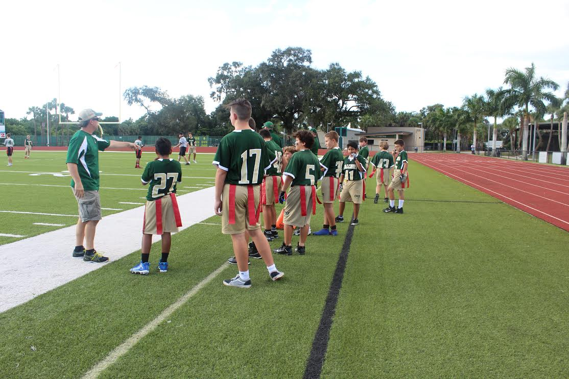 The new Saint Stephen's flag football team player anxiously await a chance to compete.
