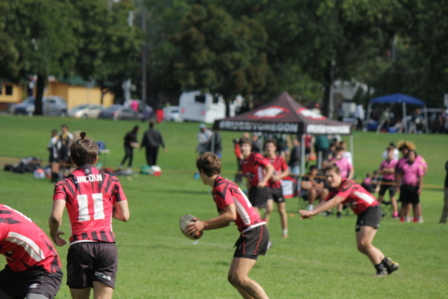 The Lincoln rugby team works their way up the field against Eastside Tsunami Pink. They won the game 33-0 on Sept. 28, 2019.