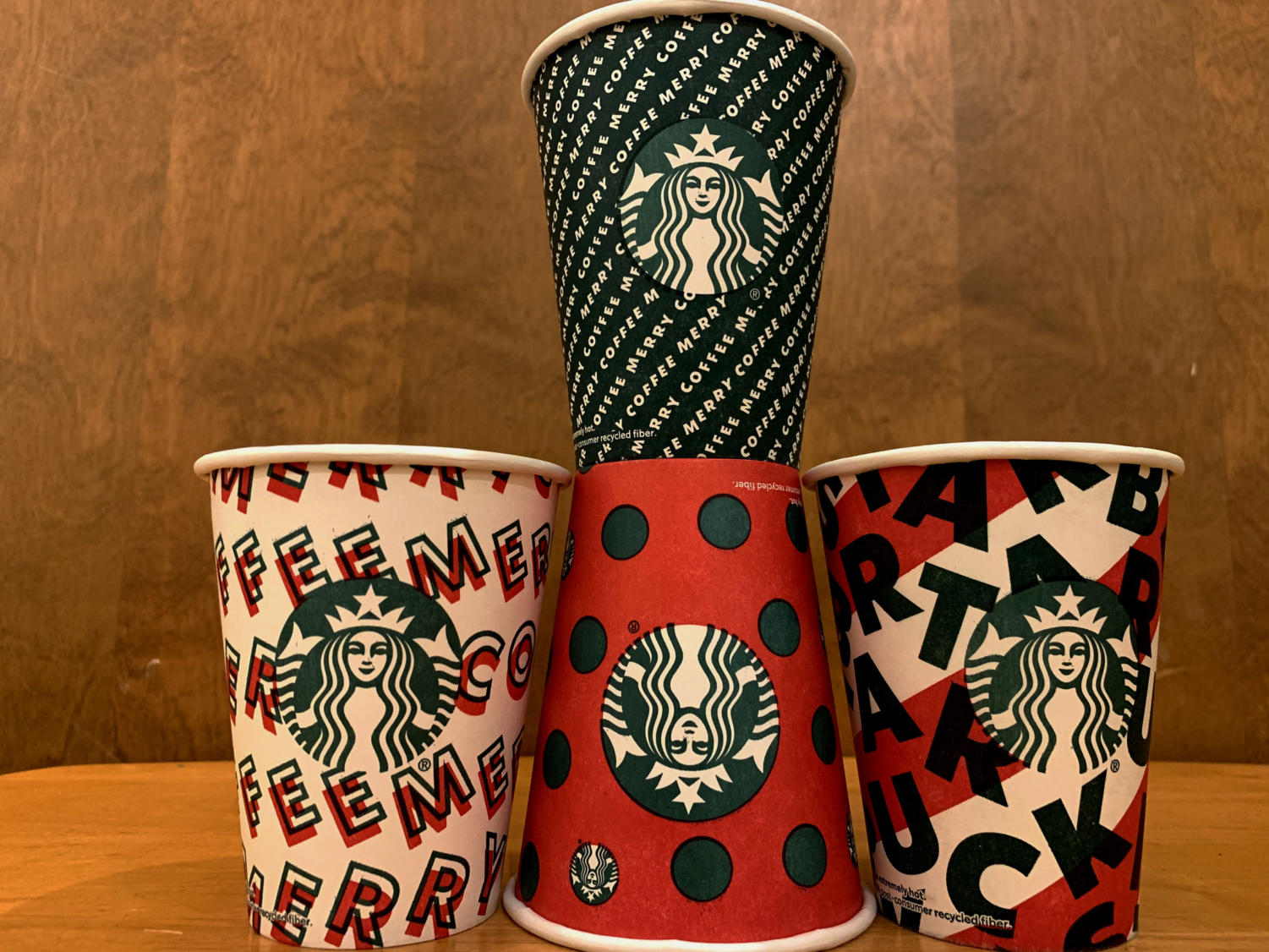 """Bold patterns grace the Starbucks cups of the 2019 holiday season.  According to Jen Quotson, vice president of Starbucks Creative, the cups are meant to represent """"a gift to Starbucks's partners and customers."""""""