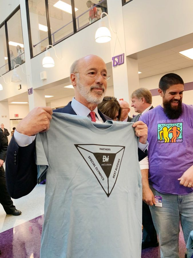 Governor+Tom+Wolf+holds+up+a+Special+Olympics+shirt.+The+governor+visited+the+high+school+on+Friday.