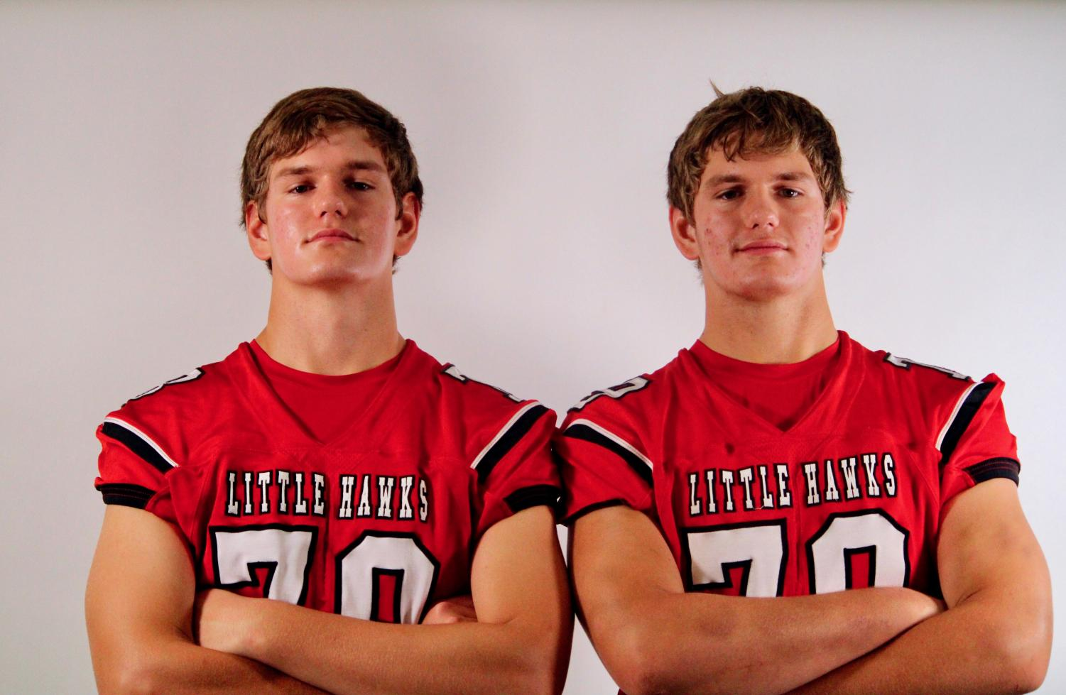 Ethan Goodrich '22 and Avery Goodrich '22 pose for a weekly football photoshoot.