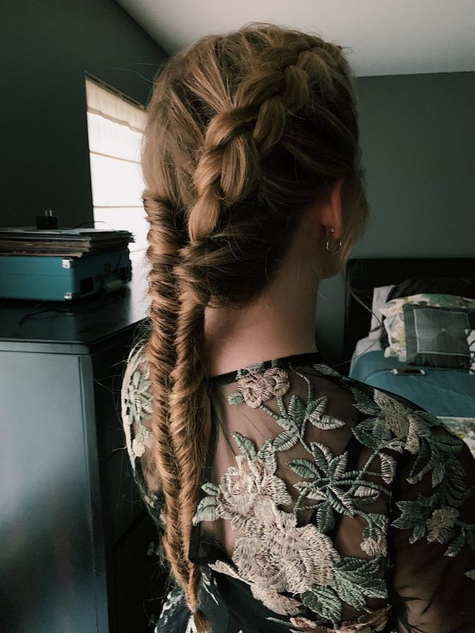 Braiding+quickly%2C+junior+Milina+Mike+does+an+intricate+braid+on+junior+Dakota+Horrocks+for+homecoming.+Mike+and+Horrocks+have+run+a+hair+and+makeup+business+since+February+of+2019.+%E2%80%9CI+am+so+proud+of+what+I+do%2C+and+I+love+when+people+are+happy+with+the+outcome%2C%E2%80%9D+Mike+said.+%E2%80%9CI+love+doing+hair+and+practicing+new+styles+on+people%2C+and+I+plan+on+doing+this+for+my+future+career.%E2%80%9D