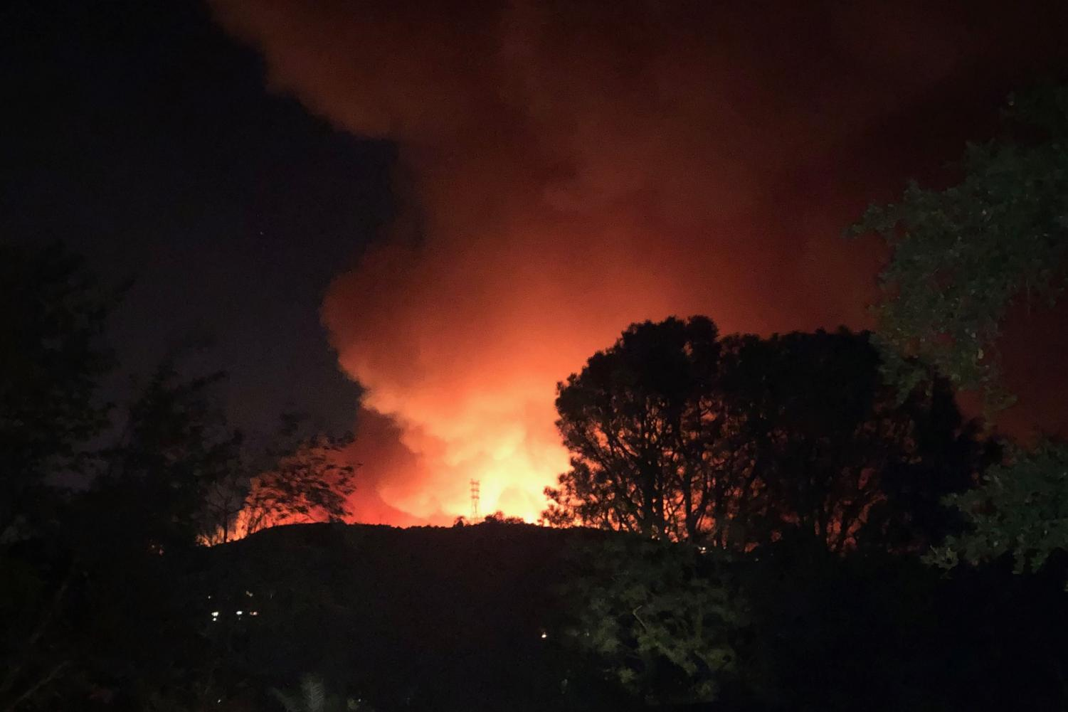 The Getty fire burns over a hill. Some families of Archer students were evacuated or faced power outages in addition to school cancellation.