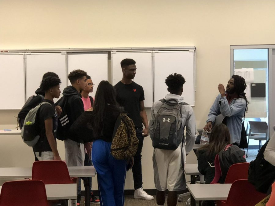 Poet+Donte+Clark+speaks+with+Monte+Vista+students+inside+the+Student+Workday+Center.+He+has+been+meeting+with+students+every+other+Thursday+where+they+have+discussed+about+racial+topics.