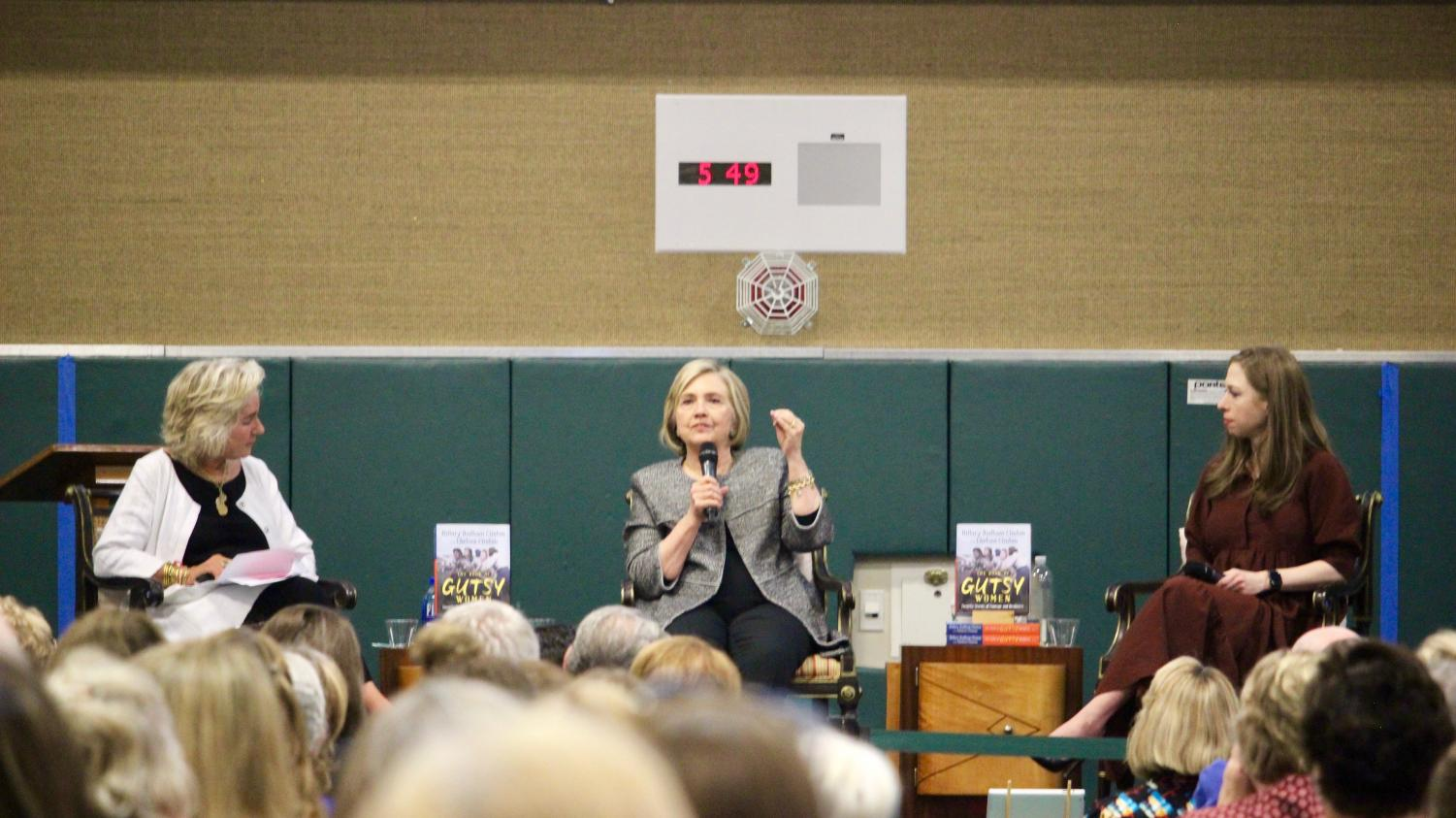 Former First Lady and presidential candidate Hillary Clinton (middle) speaks about The Book of Gutsy Women, a novel she wrote with her daughter, Chelsea (right), as moderator Susie Buell (left) leads the discussion. Students, parents, teachers and families attended the event at the San Ramon Valley High School gym and were empowered by the conversation.