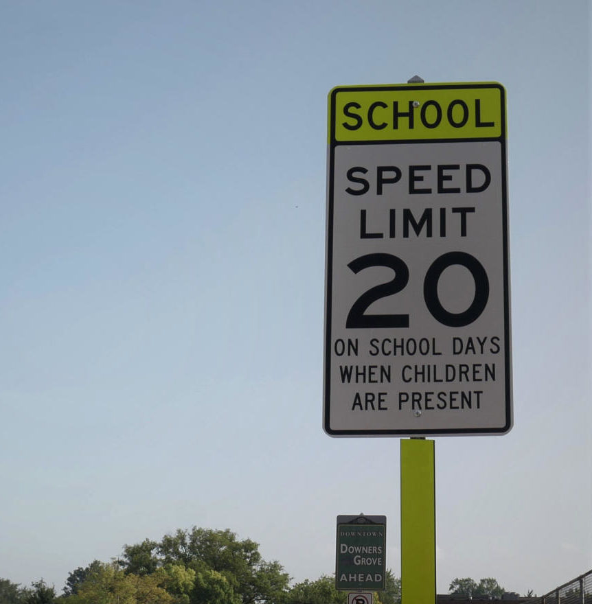 SCHOOL+ZONE%3A+A+sign+placed+near+the+Main+Street+crossing+warns+of+the+speed+limit+change%2C+from+25+miles+per+hour+down+to+20%2C+in+the+upcoming+area.+