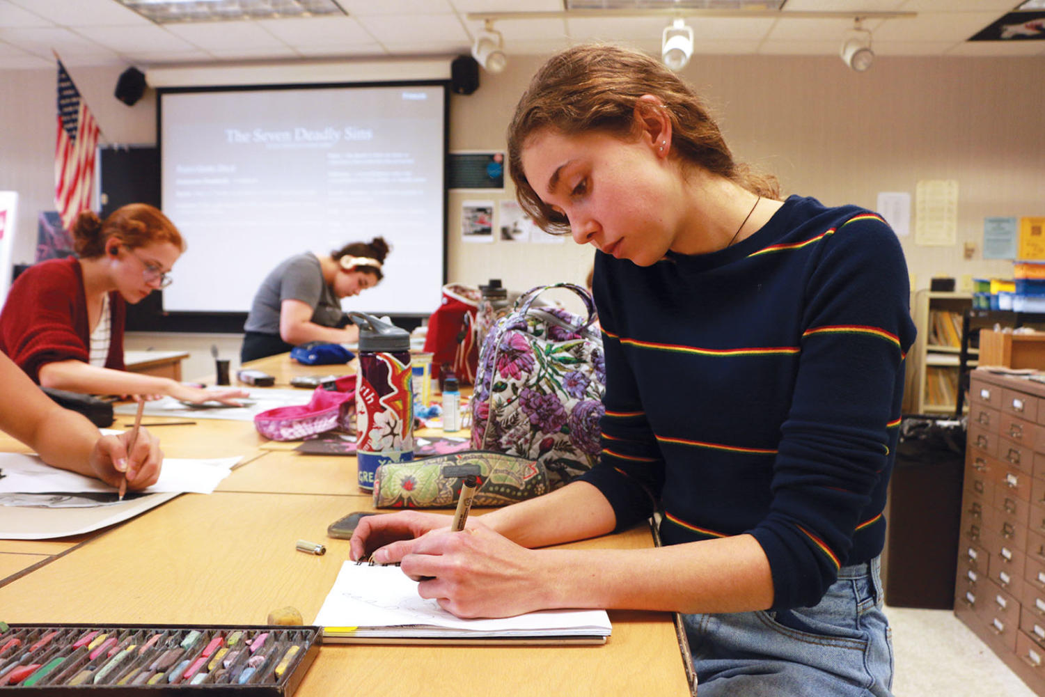 Lexi Carter, Art Club president and junior, sketches out a drawing for Inktober. Inktober is a month long challenge encouraging artists to build positive habits through ink drawing.