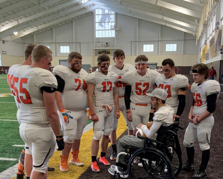 The+PHS+football+seniors+gather+around+injured+teammate+Ethan+Asher+after+being+reunited+with+him+for+the+first+time+since+Asher%27s+accident.