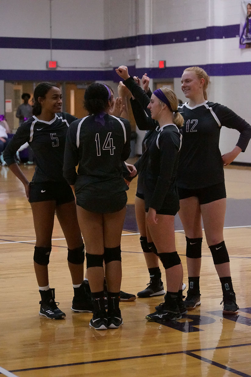 The Volleyball team breaks down a huddle before the start of the game against Louisburg October 22.