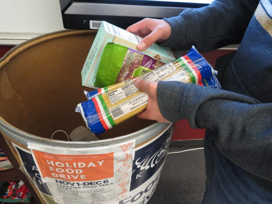 Helping+the+hungry%3A+Sophomore+Will+Charlop+donates+food+for+the+Grady+Food+Bank+Club%27s+food+drive.+Dry+goods+and+non-perishable+items+are+accepted+for+the+drive.