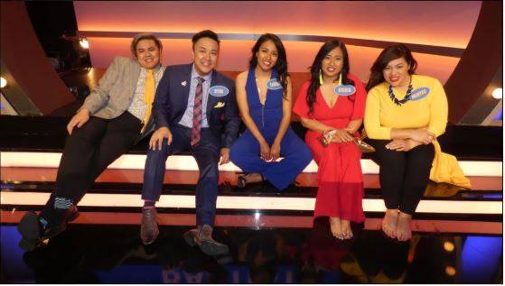 (Left to right) Family members: Trey Bautista, Ryne Bautista, Leana Funa, Cottonwood Creek Elementary fourth grade teacher Krixia Funa and Mintee Bautista sit together on the set of Family Feud in Los Angeles. Krixia Funa and her family appeared on the famous game show and won a 2,000 cash prize and Jeep.