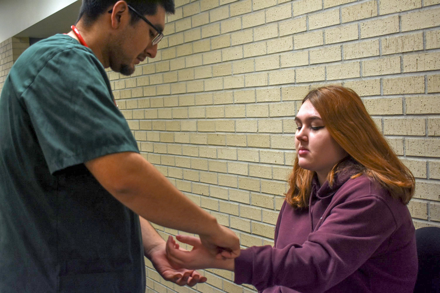 Jaime Torres practices taking pulse and blood pressure. The Liberal nursing major chose to ignore the masculinity stigma of male nurses by focussing on his passion for caregiving.