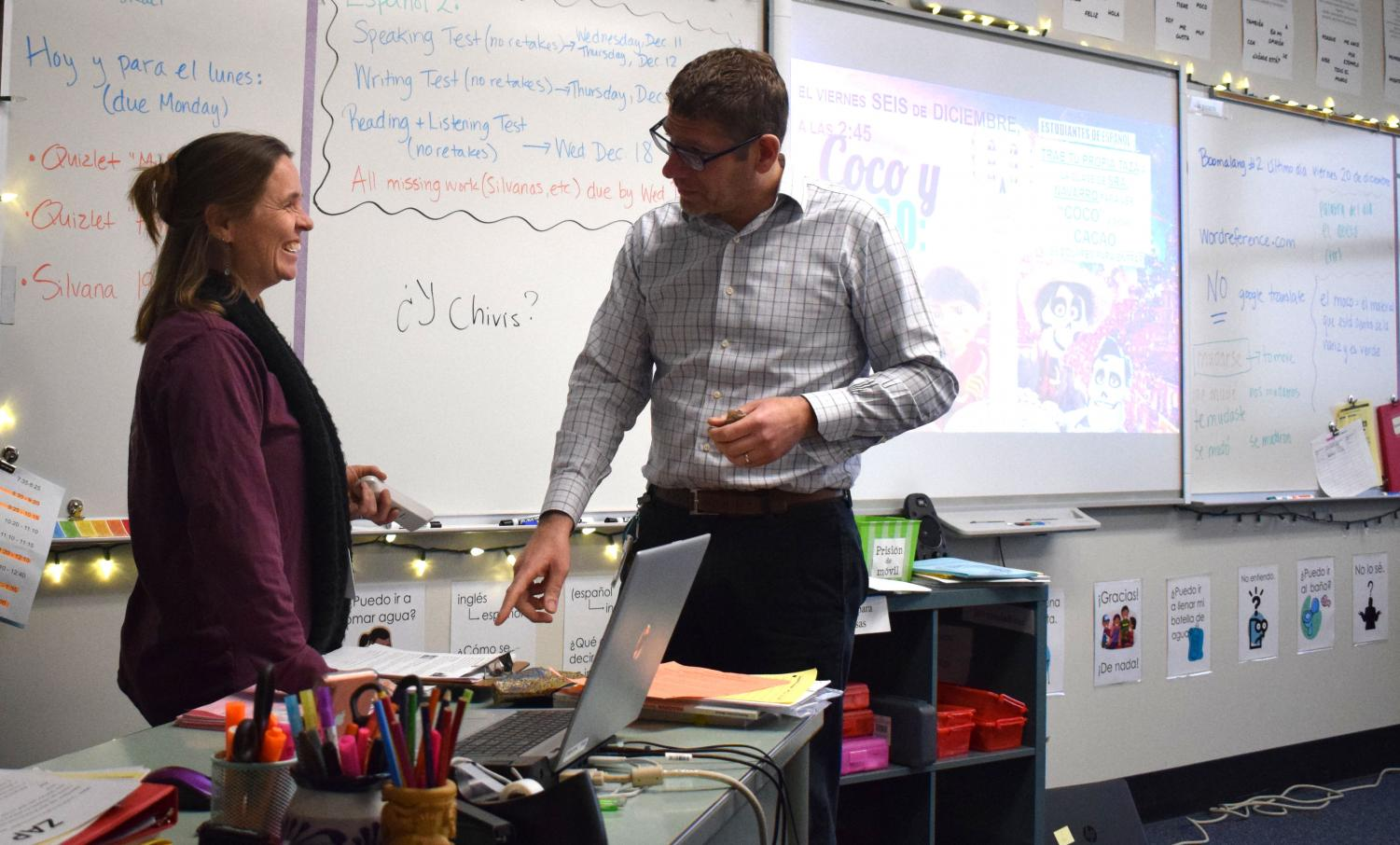 """During fourth hour planning period, Dominique and Francisco Navarro discuss lesson plans. The Navarro's enjoy sharing teaching strategies and having the opportunity to brainstorm what is best for students together. ''I love to inspire people and [make them] a little more open-minded to the world around us,"""" D. Navarro said."""