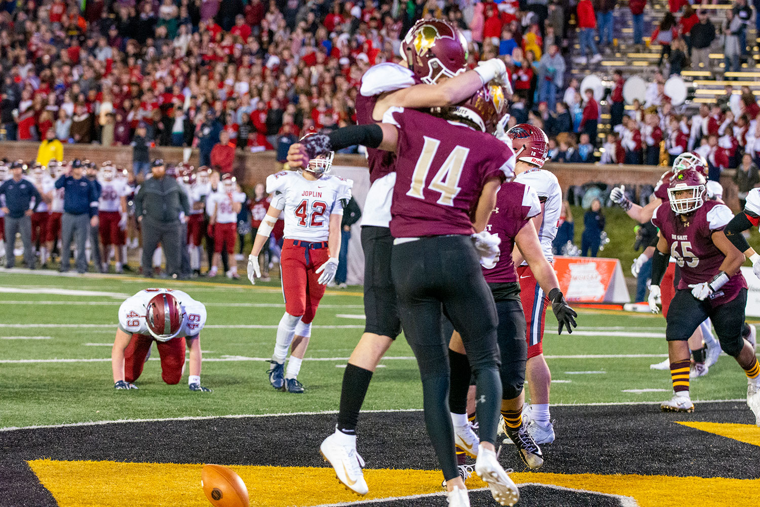 Senior QB Michael Wheeler scores a TD with 1:14 to play in the fourth quarter to give the Spartans a 35-20 lead in the state championship game against Joplin.