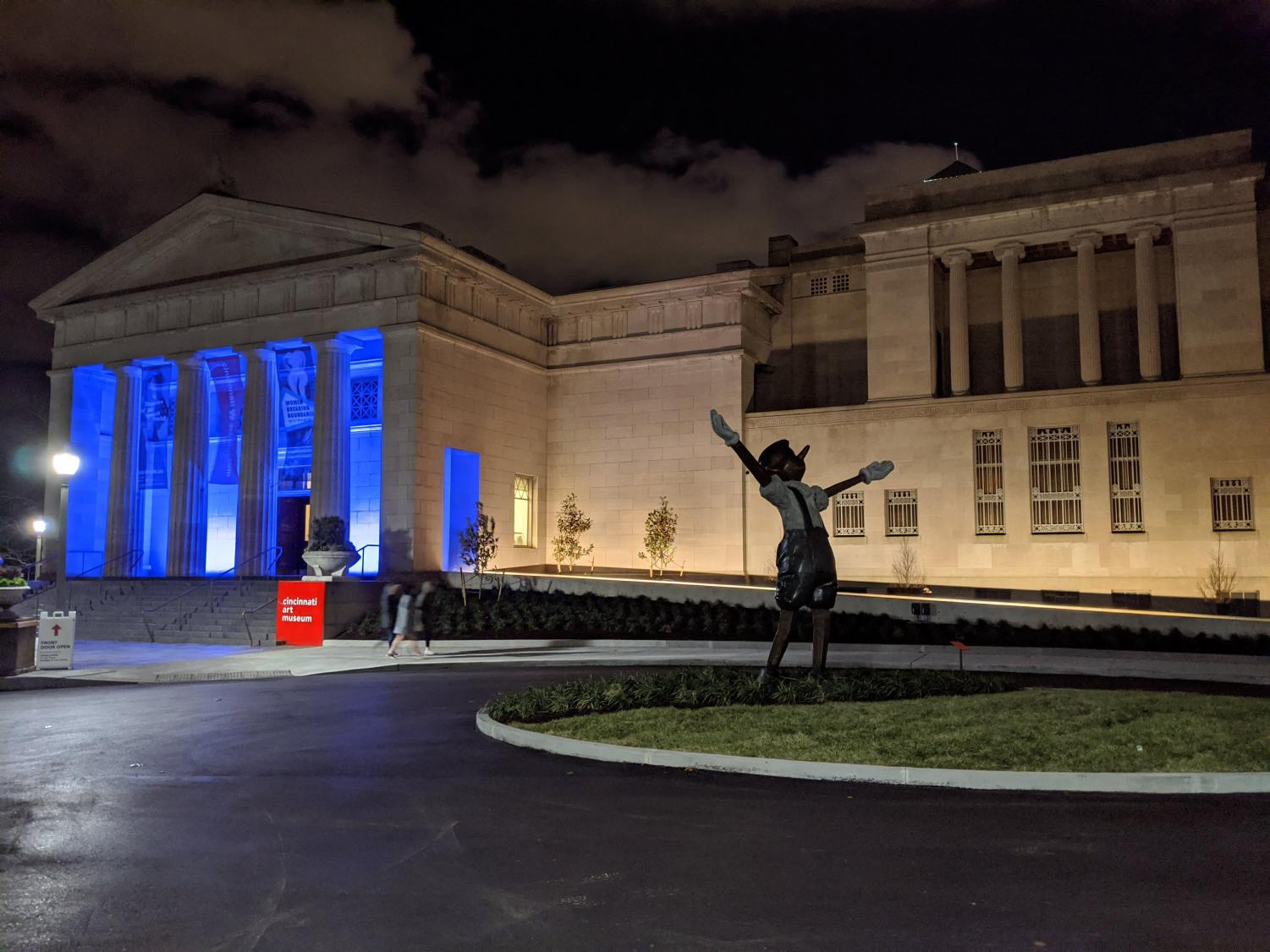 The Cincinnati Art Museum's front entrance ramp stands illuminated at an Art After Dark event. Construction on the ramp began in late February, and it was officially unveiled on Oct. 17. The ramp is part of the museum's accessibility initiative. With the addition of this ramp, older patrons and patrons with physical disabilities no longer have to solely rely on the wheelchair-accessible access located at the back of the museum.