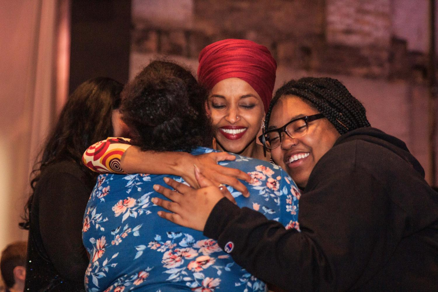 Congresswoman Ilhan Omar (D-MN) embraces supporters at her reelection campaign kickoff event before taking the stage Jan. 23.