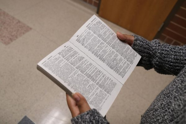 During 6th period, Rosalinda Sanchez, 11, reads an English dictionary in the hallway at Mansfield Legacy High School on Jan. 22. The English Language Learners (ELL) learn English through core classes.